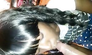 Jeune fille noire suce une bite black longue de vingt centimètres